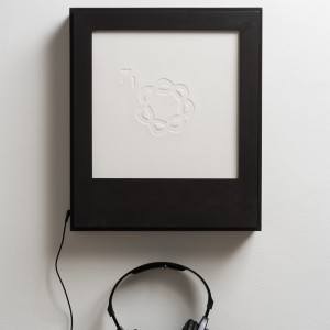 Maya Attoun, Knot theory, 2016, Embossing, plywood, MP3 player, headphones. Photography: Youval Hai