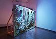 מולטיפלורי (2010), גלעד רטמן, וידאו חד-ערוצי, הקרנה על קונסטרוקצית עץ, לופ. תערוכת לרווה, צילום, שלמה סרי