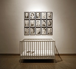 Raised by Man, Uri Radovan, 2019, 15 pencil drawings on paper, 23x31 cm each; crib, 123x65x79 cm; book, 28x20.5 cm. photography Shlomo Seri